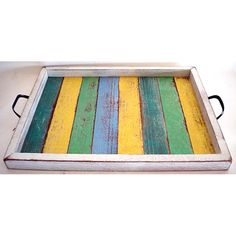 Crafted from all-natural wood, recycled from old homes, boats and schools salvaged and handcrafted in Thailand, this tray is perfect to serve up drinks and finger foods and more. This rectangular serving tray comes with metal handles.