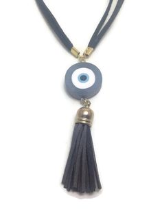 Shop for evil eye necklace on Etsy, the place to express your creativity through the buying and selling of handmade and vintage goods. Evil Eye Jewelry, Evil Eye Necklace, Tassel Necklace, Necklaces, Polymer Clay, Gifts For Her, Unique Jewelry, Pendants, Chain