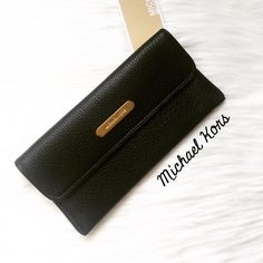 NWT Michael Kors Black Leather Flat Wallet! Brand new! 100% authentic. This wallet is perfect for all seasons! Will fit all your change, cash, and cards! Any questions, please ask! No trades. Michael Kors Bags Wallets