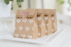 mini kraft treat bags + heart stamp + edge punch...all supplies from Michaels