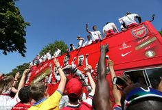 For the fans: Supporters wave and take pictures of the Arsenal victory bus on a good day t...