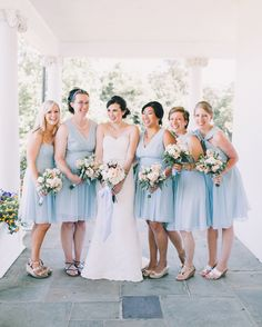 Bridesmaids in Knee Length Powder Blue Dresses at Summer Wedding