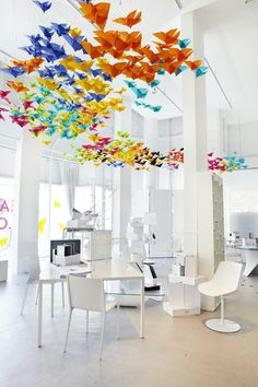 Suspended colourful origami butterflies.  A collaborative art installation by Dream Interiors & Elixr
