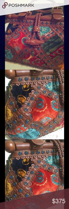 Isabella Fiore  Carpet Tilly Purse. Intricately designed velvet and suede patchwork with leather and stud trim. Frame style top with Double top handles. Measures 9H and 19L, it's like the stunning carpet bag of storybook fashion! Isabella Fiore Bags