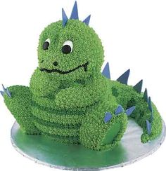 Cake - Dinosaur-loving kids will cheer when you serve this candy-scaled, spiky-tailed figure. Build the lizard from cakes baked in our Stand-Up Cuddly Bear Pan and Mini Wonder Mold Pan. Dinosaur Birthday Cakes, Dinosaur Party, Boy Birthday, Happy Birthday, Birthday Ideas, Dinosaur Cake Pan, Boys Birthday Cakes Easy, Girl Dinosaur, Birthday Quotes