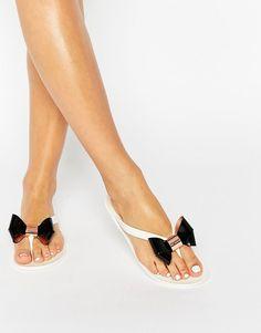7624f978a98c0e Image 1 of Ted Baker Ettiea Cream Black Bow Jelly Flip Flops