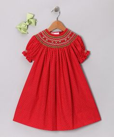 Cute geometric smocking on polka dot. I can see this with different colored stitching for summer.