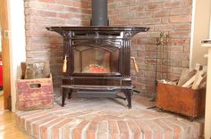 wood stove with brick hearth for corner of living room.but just do floor brick and not backdrop Wood Stove Surround, Wood Stove Hearth, Brick Hearth, Fireplace Hearth, Stove Fireplace, Wood Burner, Brick Fireplaces, Wood Burning Stove Corner, Corner Stove