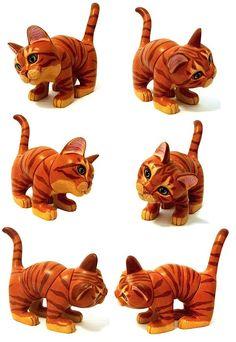 """Твист-O-Cat. Как исполнительный """"игрушки"""" или любимой семейной реликвией это """"только-один-в-мире, как-то"""" кошка  суждено бесконечно развлекать и вдохновлять. Размеры: 8 """"длина х 7"""" высокий (лапа до кончика хвост) х 3 """"широкий веса 14oz. Цена: $ 7000 USD"""
