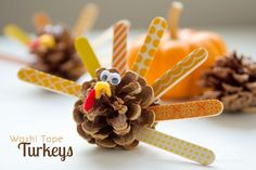 Washi Tape Pinecone Turkeys! What an adorable Thanksgiving craft for kids. I'm always looking for new ways to use washi tape!
