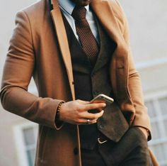 Topcoat, camel coat, brown vest, brown tie, and sunglasses. Sharp Dressed Man, Well Dressed Men, Fashion Mode, Suit Fashion, Style Fashion, Classy Mens Fashion, Fashion Vintage, Fashion Styles, Fashion Photo