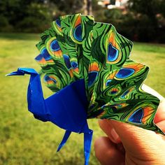Year of Procrastination: Day 108. Folding peacock #origami favors.