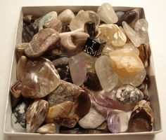 Tumble-polished stones - petrified wood, quartz, amethyst, agate, jasper, meteorite, and others.