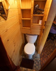 The toilet inside the Roly Poly at Caravan fits perfectly underneath shelves. Michael Lloyd/Staff.