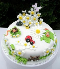 "The inspiration for this cute garden bug cake was the sales display in Debenhams for Marc Jacobs ""Daisy"" perfume (Cake Decorating) Pretty Cakes, Cute Cakes, Beautiful Cakes, Amazing Cakes, Fondant Cakes, Cupcake Cakes, Fondant Rose, Cupcake Toppers, Bolo Laura"
