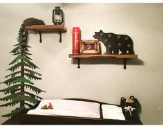 Shelving detail of Lumberjack Nursery. Antique thermos, oil lantern and coon skin hat.