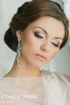 Stunning Wedding Hairstyle & Makeup. Beautiful and subtle eyes with peach lips. Love the sparkly earrings! | #clairetaylormua  Have a special event coming up? Visit www.thebeautyspotqld.com.au for more info!