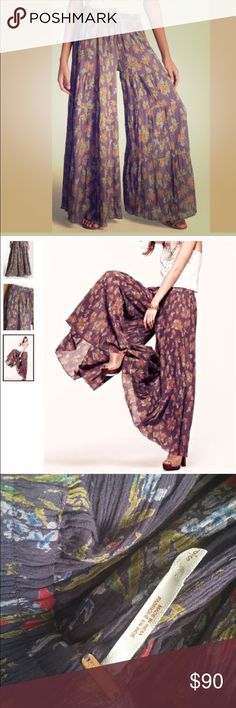 Free people gauze tiered pants On the fence about selling! Gorgeous purple gauze, 3 tiered gaucho pants. I will double check inseam- it is around 30 with elastic waist. Free People Pants