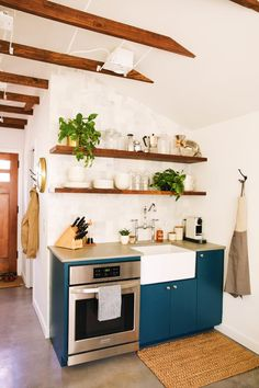 New Darlings - Home Remodel- #openshelving #coloredcabinets #exposedbeams #kitchenette #Potterybarn