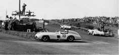 TT 1955 ♦ Stirling Moss on his way to winning in his Mercedes-Benz 300 SLR. This would be Mercedes-benz final race in 35 years due to the Le Mans tragedy earlier in June of that year.