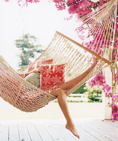 Woman relaxing in a hammock | Baby, it's hot outside―and inside, too. Here, no-sweat ways to cool off.