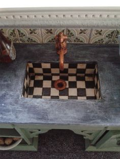 Miniature House: Kitchen Sink....love this farmhouse style sink with slate counter and copper fixtures