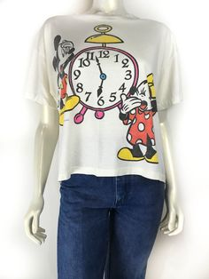 Perfectly worn soft Vintage Mickey and Minnie clock tee. Shop prettypennyclothing.com