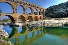 Pont du Gard, Roman aqueduct near Nimes, France We came here and it's one of the 8 wonders of the world! Its a 2000 plus years old roman aqueduct! I hung out there!