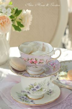 Beautiful floral English teacup stack in pastels with macaron and rose petals - *sigh*  Aiken House and Gardens blog
