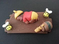 Check out this item in my Etsy shop https://www.etsy.com/listing/288241235/fondant-winnie-the-pooh-baby-cake-topper