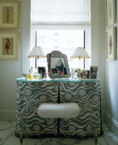 Hmmmm possibly cover the window seat with a skirted vanity