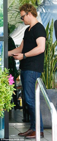 Casual fellow: The 46-year-old Australian actor looked handsome as he sported a black t-sh...