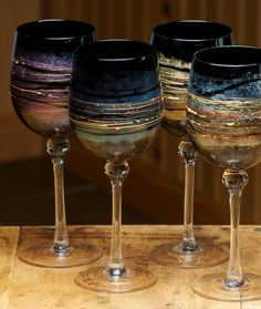 Set of Four Black Mist Handpainted Wine Glasses in Purple, Gold, Blue and Green Black Wine Glasses, Glitter Glasses, Cool Glasses, Decorated Wine Glasses, Hand Painted Wine Glasses, Wine Glass Designs, Stained Glass Paint, Glass Ceramic, Glass Art
