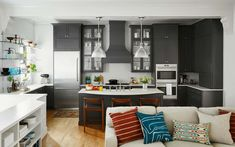 Color and dark gray kitchen mix well in this Bucktown Condo Reveal by Centered by Design. Photography by Dustin Forest. Layout Design, Design Ideas, Dark Grey Kitchen Cabinets, Oak Cabinets, Interior Blogs, Ikea, New Kitchen Designs, Cabinet Decor, Kitchen On A Budget