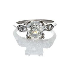 US$19,250 Asscher cut diamond engagement ring,Circa 1940. 2.03 ct H color and SI1, four transitional cut diamonds (total weight .10 cts) set into the shoulders. Platinum.