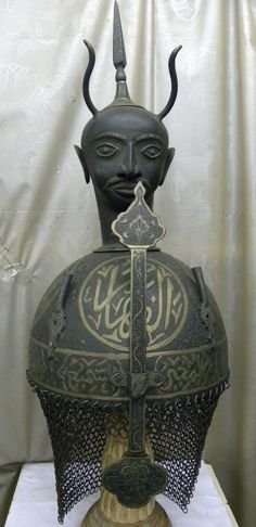 OTTOMAN /TURKISH ISLAMIC WARRIOR DEMON DEVIL FACE HORN HELMET [TC/302] A true unique magnificent Ottoman Turkish Islamic Persian empire khula khud battle warrior Demon Devil face and horn helmet . The Turkish Ottoman soldiers use to wear turbans and as such this helmet is larger than usual helmets. Helmet Armor, Arm Armor, Chainmail Armor, Battle Axe, Mughal Empire, Knight Armor, Swords And Daggers, Ottoman Empire, Harbin