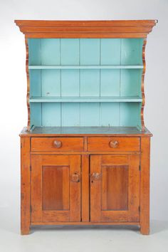 American, small open cupboard, 19th century, base has paneled doors and two drawers, open top has scalloped sides and crown molded cornice, 64 H. x 39.5 W. x 16.75 D.