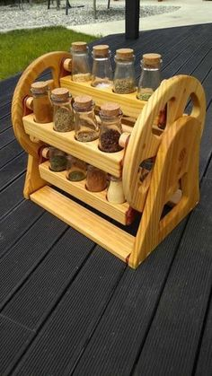 Like the idea of a spice carousel but prefer darker wood & test tubes like an apothecary.