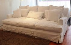 The Jillian This just might be the deepest sofa in Seattle. at 55″ deep it's deeper than a twin bed. Shown in a PLUSH down blend and slip covered in hard wearing (and machine washable) white denim I don't have words for this sofa.  It is DELUXE in every possible way.  A sofa you definitely climb into rather than sitting on. $2950 as shown, but also available in many colors.