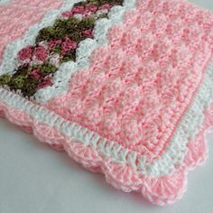 A gorgeous, handmade, keepsake baby afghan would make a perfect baby shower gift or an heirloom to be passed down through the family. It would also be a fantastic photo prop too! Generously sized for crib use, it's ideal for the newborn infant baby, toddler or young child or it could even be used as a throw blanket, a lapghan, a lap robe or for wheelchair use.The design is written in standard U.S. terminology and was inspired by a Barbara Berger creation. The Cameron Baby Blanket crochet…
