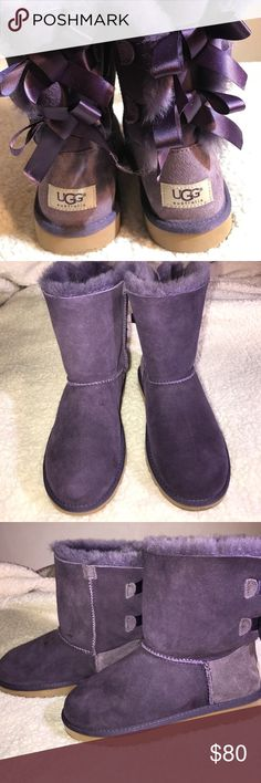 EUC Girls UGG Bailey Bow in purple size 4 These are EUC Girls UGG Bailey Bow boots in purple size 4. No longer have the box. Will fit women who are size 6. UGG Shoes Boots