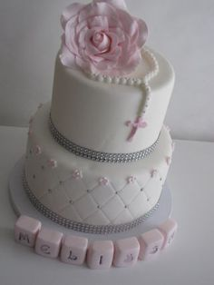 I have to say that this is a very popular cake on Pinterest. I don't think there is a original designer, Because I have seen this cake too many times..I had a great time making this cake for my best Friends Daughter Melissa, on her First Holy...