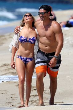 Pin for Later: The Best Celebrity Vacation Pictures From 2014!  LeAnn Rimes and Eddie Cibrian flocked to Hawaii for PDA in paradise.