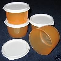 Tupperware 4-Ounce Snack Container Set, Orange by Tupperware. $15.79. Backed by Tupperware's Lifetime Warranty. Set of 4 versatile 4-oz. (120 mL) containers with seals.. Orange Ice container with White Seals.. Dishwasher Safe. Seals include a small tab for easy removal. Perfect for bite-size snacks or single servings.  With their virtually airtight and liquid-tight seals, you can fill these containers with a snack and carry in a purse, briefcase or backpack and not worry ...