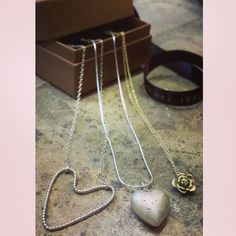 Romantic pendants out of the box. Gold and silver pendants by Rachel Jeffrey. Hearts, diamonds, roses