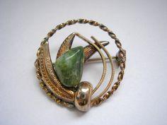 Vintage gold tone metal round brooch with jade stone by badgestuff, $5.00