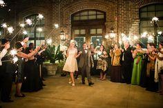 The bride and groom making their grand exit in Savannah, Georgia with photos by Scott Hopkins Photography | via junebugweddings.com