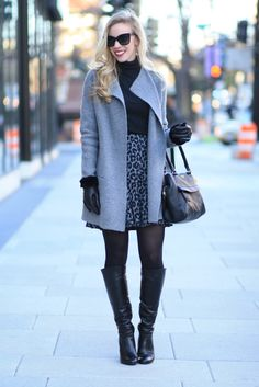City Lights: gray sweater coat, gray and black snow leopard skirt, black turtleneck, Stuart Weitzman black leather knee high boots, black leather gloves with fur cuff, black and gray winter outfit