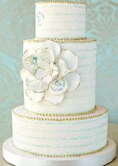 gold and floral wedding cake. this would be neat with a light purple instead of the blue.