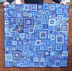 log cabin quilt. I love the random look of this - so much more my style than precision-looking quilts.